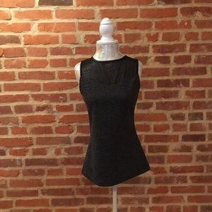 Express tweed bodice top with mesh and leather.